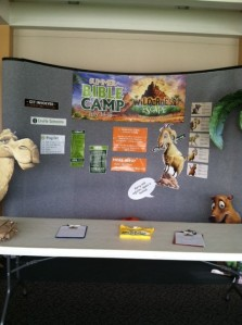 Our display (minus our tablecloth) for sign-ups/donation drop off in our main hallway