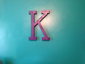 One of the finished walls - she loves her teal and purple color scheme!